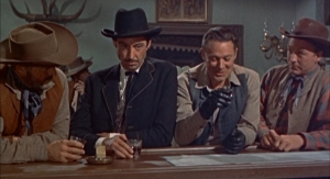 "Masterson of Kansas (1954): ""What do we drink to now, Doc?"" cattle baron Charlie Fry (William Henry) asks Doc Holliday (James Griffith). From left to right: Gregg Barton, Griffith, Henry, and stuntman/actor Sandy Sanders."